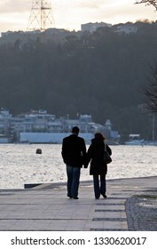 Lovers walking at Rumeli Fortress Seaside in Bosphorus, Istanbul, Turkey.