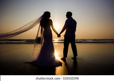 Lovers were married in India. Walk on the beach
