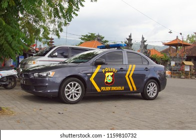 Lovina, Bali, Indonesia - August 8, 2018: Indonesian Mitsubishi Lancer Municipal Police car