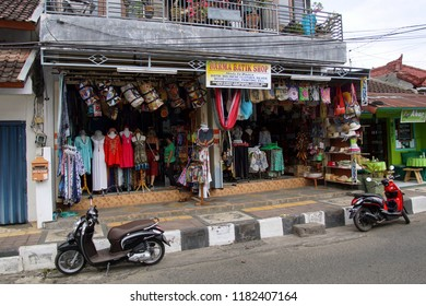 Lovina, Bali, Indonesia - August 8, 2018: Two motorbikes in fornt of a souvenir shop in the city of Lovina.
