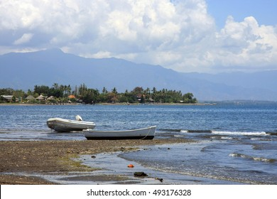 Lovina Beach in Bali, Indonesia - view of beach and sea with boats in foreground