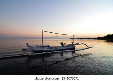 Lovina,Bali/Indonesia-Circa 2009: A Jukung at Lovina.Jukung is traditional small wooden Indonesian boat.