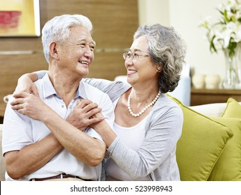 loving asian couple looking at each other smiling with appreciation