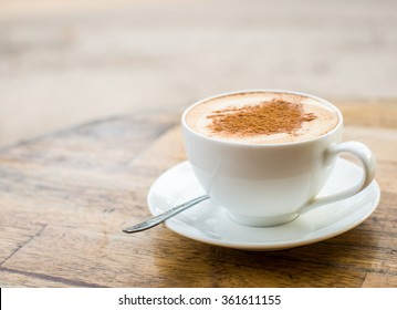 Loving coffee. Cup of fresh cappuccino  with heart sign