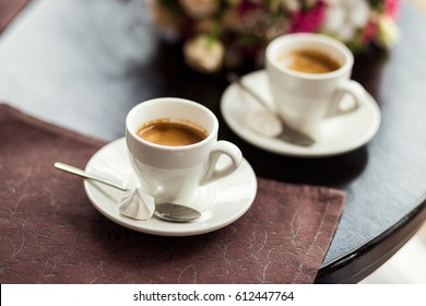 loving couple drinking coffee with candies in a restourant
