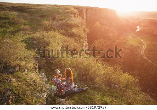 Loving couple embracing on a mountaintop.