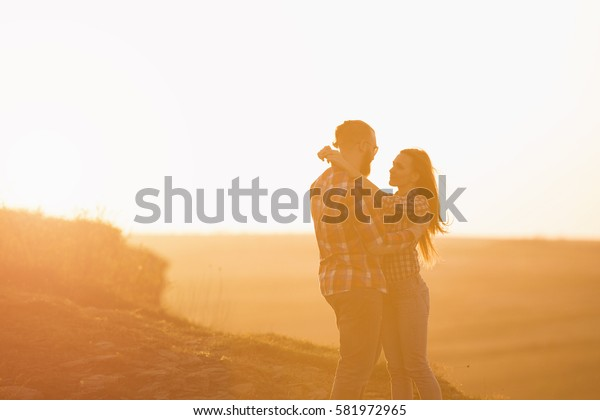 Loving couple embracing on a mountaintop