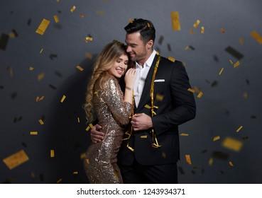 Loving couple embracing at studio shot
