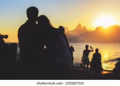 Loving Couple Enjoying the Sunset in Ipanema Beach, Rio de Janeiro, Brazil
