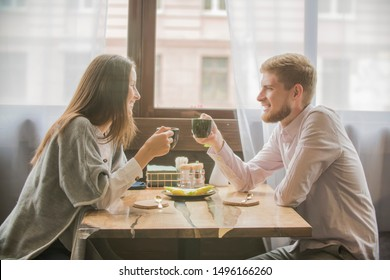 loving couple guy and girl on a date in a cafe