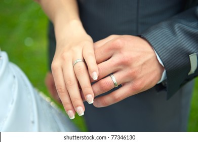 Loving couple holding hands with rings