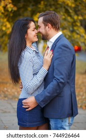 A loving couple hugging in an autumn park.