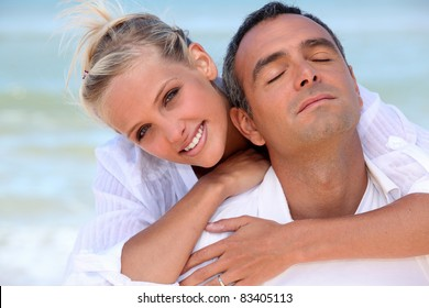 Loving couple hugging on the beach