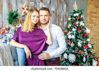 Loving couple hugging in the room. Concept of Merry Christmas, New Year, holiday, winter, traditions.