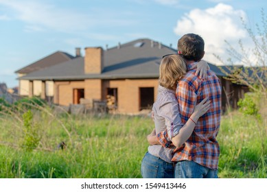 loving couple looking on house