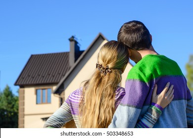 Loving couple looking at their dream house. copy space