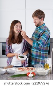 Loving couple made a pizza at home