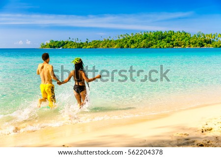749cffb06 A loving couple, man and woman enjoying summer vacation on a tropical  paradise beach with