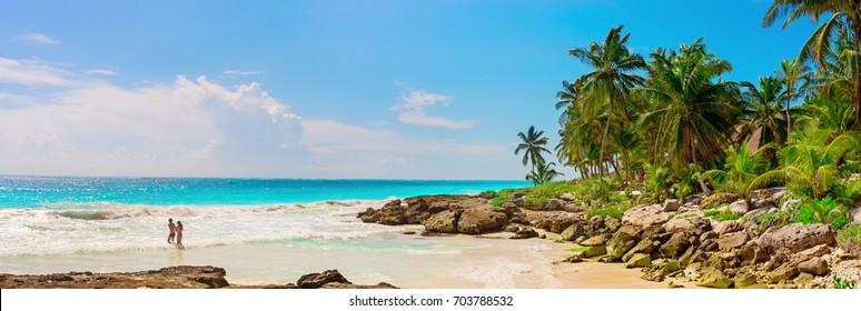 A loving couple, man and woman at tropical sandy Beach on Caribbean Sea. Yucatan, Mexico.