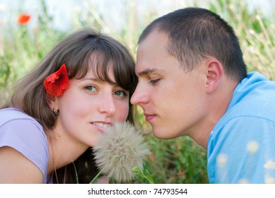 loving couple in the middle of flowers