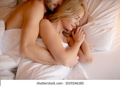 Loving couple on the bed in the bedroom