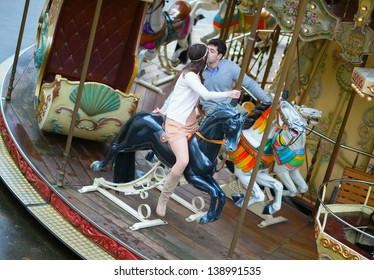 Loving couple on a merry-go-round