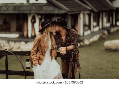 Loving couple on a  ranch in the western mountains in the autumn season. Elopement concept