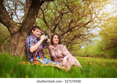 Loving couple on a spring meadow