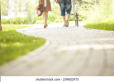 loving couple in a park with a bicycle