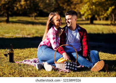 Loving couple in park.Couple having picnic at park
