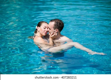 loving couple in the pool