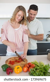 Loving couple preparing food together at kitchen counter