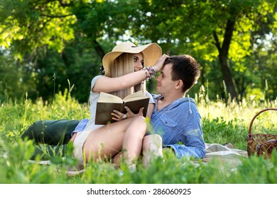 A loving couple reading a book on nature