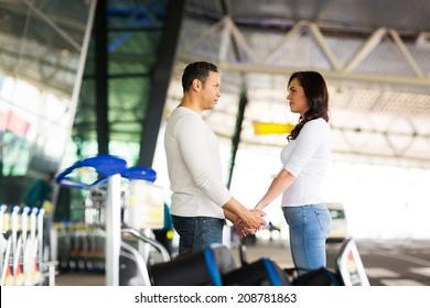 loving couple say good bye at airport