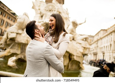 Loving couple sightseeing on travel vacation in Rome, Italy