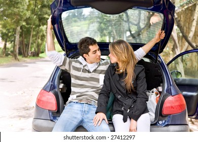 Loving couple sitting in the back of a car