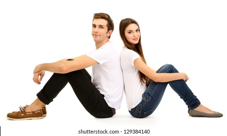 Loving couple sitting with back to each other on floor isolated on white