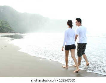 loving couple spending quality time with each other on beach