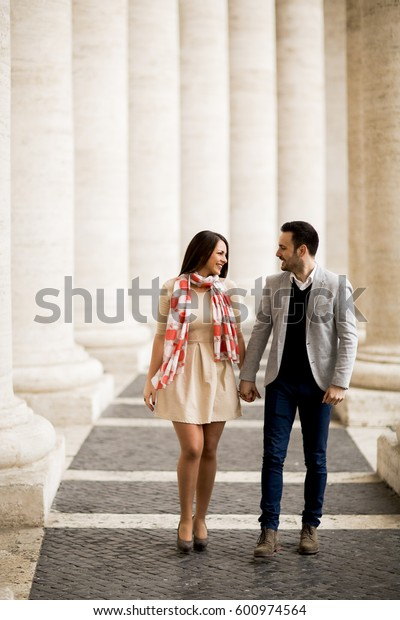 Loving couple at the St. Peter's Square in Vatican