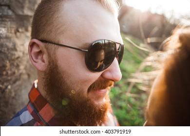 Loving couple, sunset, a man with a beard