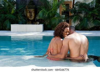 Loving couple in swimming pool