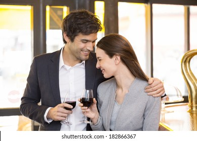 Loving couple takes a drink in restaurant