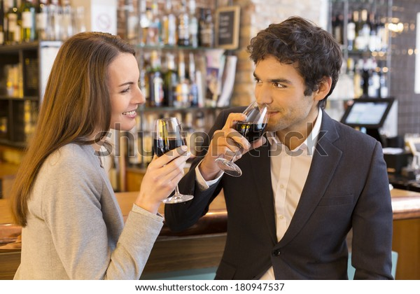 Loving couple takes a red wine glass in restaurant