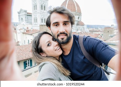 Loving couple taking a selfie in front of the church Santa Maria del Fiore, Florence Cathedral