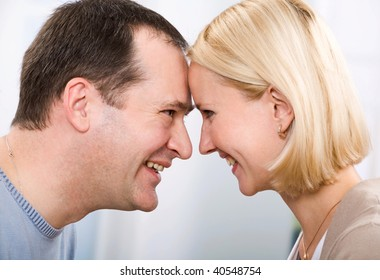 Loving couple, touching by foreheads