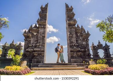 Loving couple of tourists in budhist temple Brahma Vihara Arama Banjar Bali, Indonesia. Honeymoon