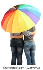Loving couple with umbrella isolated on white