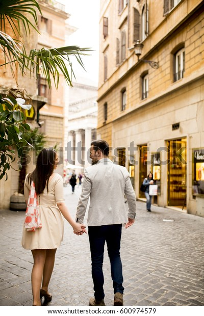 Loving couple walking on the street of Rome, Italy