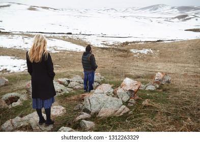 Loving couple in the winter landscape