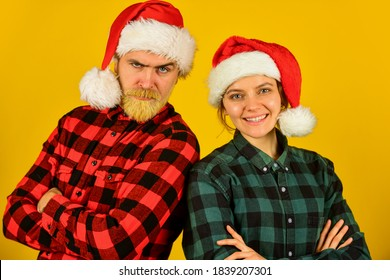 Loving couple yellow background. Christmas magical time. We love christmas. Couple in love enjoy christmas holiday celebration. Family wear santa hats. Entertainment ideas for adults. Santa team.